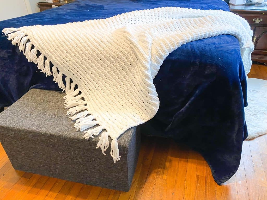 Check out this quick and easy crochet blanket pattern. Perfect size for a king sized bed throw and makes a gift everyone would love. This farmhouse style blanket is made using super bulky Bernat Baby Blanket yarn. Gift tags are included in low cost ETSY pattern purchase.