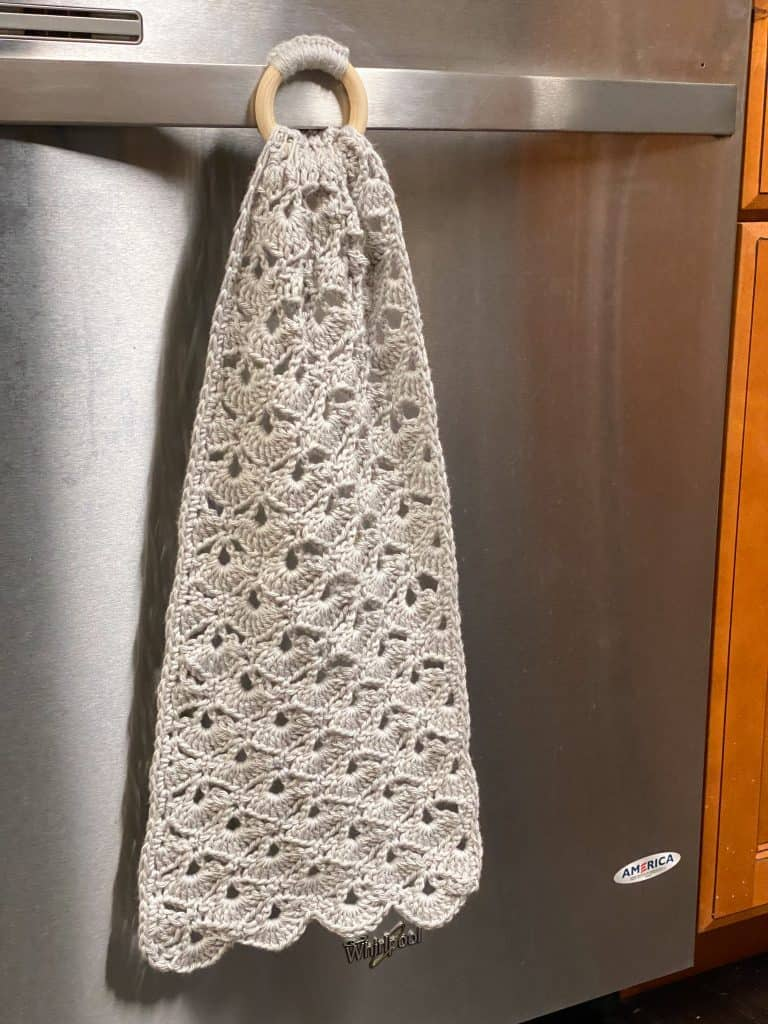 This decorative dish towel makes a great gift! The wooden ring makes this towel super easy to attach to your oven or dishwasher. Using I Love this Cotton yarn from Hobby Lobby or any other 100% cotton yarn.